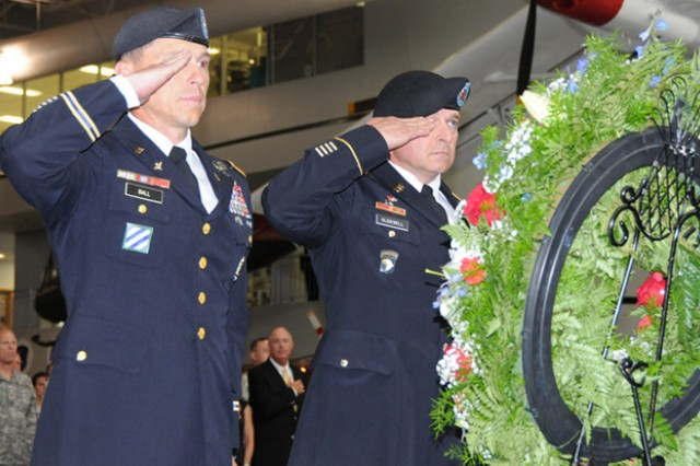 Col. Daniel Ball, USAACE chief of staff, and Aviation Branch Command Sgt. Maj. Tod Glidewell salute a wreath to the fallen Soldiers at the installation Memorial Day ceremony at the U.S. Army Aviation Museum, May 26.