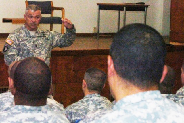 Command Sgt. Maj. Tod L. Glidewell, the senior enlisted Soldier of the Army's Aviation Branch, speaks with NCOs of the Combat Aviation Brigade, 1st Infantry Division, at Fort Riley, Kan., briefing them on what lies ahead for them and their Soldiers.