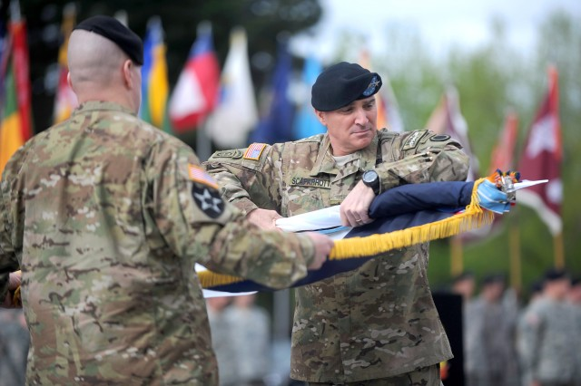 Lt. Gen. Mike Scaparrotti, right, I Corps commanding general, and Command Sgt. Maj. John Troxell case the I Corps colors May 26, 2011, during the unit's deployment ceremony at Joint Base Lewis-McChord, Wash.