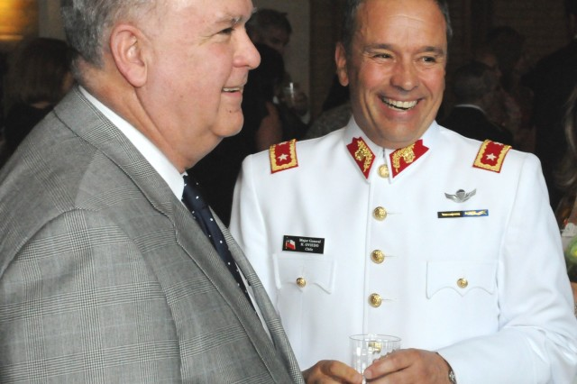"""Under Secretary of the Army Joseph W. Westphal talks with Maj. Gen. Humberto Oviedo, Chilean Army, at a reception priot to a Twilight Tattoo performed by members of The 3rd U.S. Infantry Regiment (The Old Guard) and The U.S. Army Band """"Pershing's Own""""."""