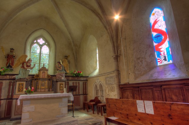 A stained-glass window in the church of Angoville au Plain, France, casts a light to the memory of U.S. Army paratroopers who wrested the village from the German army following the Allied invasion of France June 6, 1944.  The church was once used by two Army medics to care for over 70 U.S. and German soldiers as fighting raged outside.