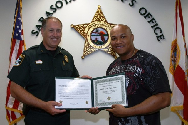Sarasota, Fla., Sheriff Tom Knight presents a Certificate of Recognition to Staff Sgt. Eddie Peoples for his role in apprehending a bank robber.