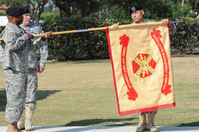 Maj. Gen. Reuben Jones, left, and Command Sgt. Maj. Abe Vega, prepare to case the Family and Morale, Welfare and Recreation Command's colors June 3, 2011, to mark the deactivation of the organization at Fort Sam Houston, Texas, while Lt. Gen. Rick Lynch watches.