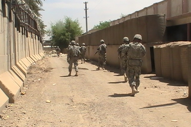 BAGHDAD - Soldiers from C Trp, 6-9 Cav., 2nd AAB, 1st Inf. Div., USD-C, conduct a quick foot patrol around the perimeter of JSS Shield on May 22 during a recent security mission.