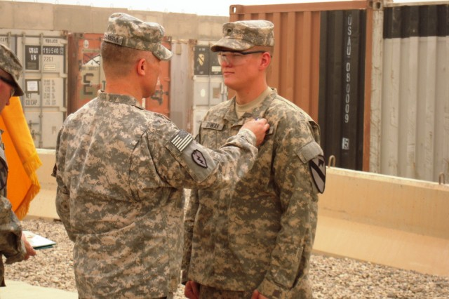 BAGHDAD - Brig. Gen. Paul LaCamera, DCG-Ops., 25th Inf. Div., awards Spc. Christian Cowan, a Combat Medic with Apache Troop, 6-9th Cav., 2nd AAB, 1st Inf. Div., USD-C, the Purple Heart on 2 Jun. at Camp Liberty, Iraq. Spc.