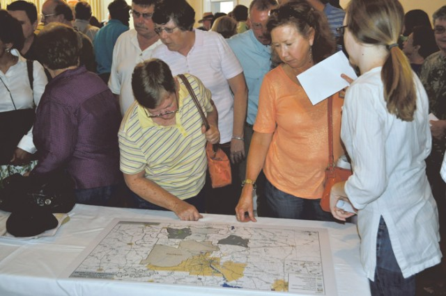 Stewart County residents look at land survey maps during Monday's meeting in Richland, Ga.