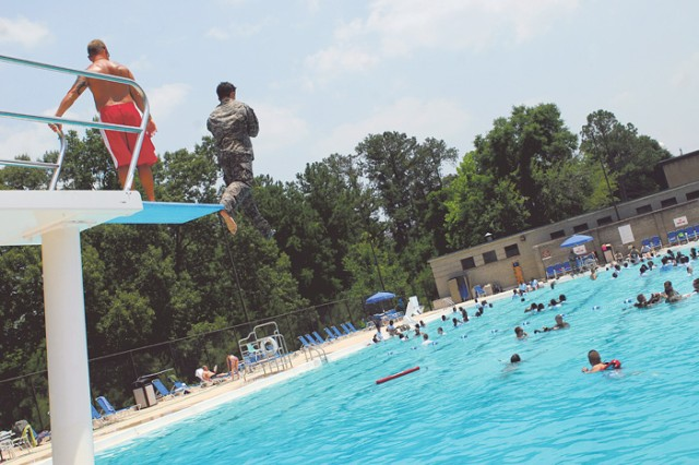 Cadets learn to use their uniforms as flotation devices during a drown-proofing session at the Kelley Hill pool Thursday