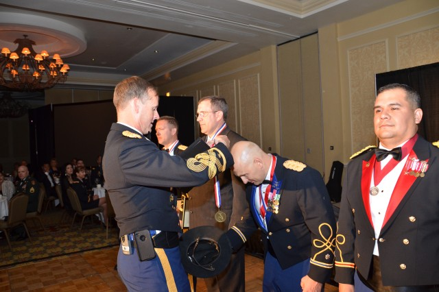 Lt. Col J. Dave Price, Commander, 1st Space Batallion, is awarded the medallion by Col. Timothy R. Coffin, Deputy Commander for Operations, USASMDC/ARSTRAT.