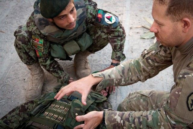 Cpl. Joel M. Kuhn, a combat medic and native of Brazil, teaches a medical class to Afghan soldiers at Nangalam Base in eastern Afghanistan's Kunar province, May 30, 2011. Kuhn received his U.S. citizenship through his Army service.