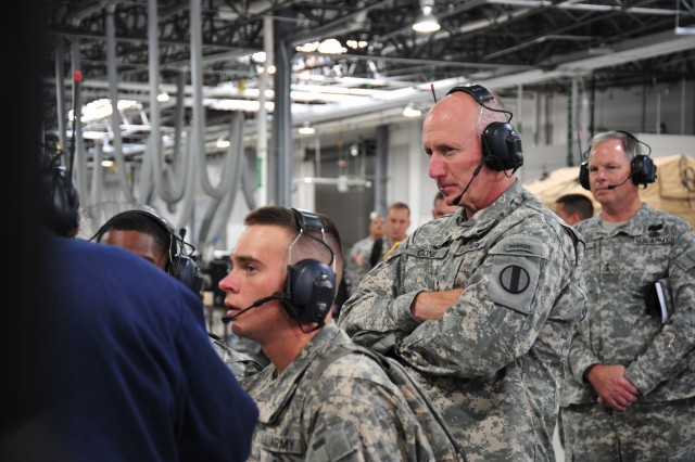 Gen. Robert W. Cone, Training and Doctrine Command commanding general, observes Power Generation Equipment Repairers June 2 while they perform engine diagnostic troubleshooting as part of their training. Cone and the advanced individual training Soldiers are wearing noise-cancelling, wireless headsets that allow the instructor to communicate with the students without any noise interference from the equipment.