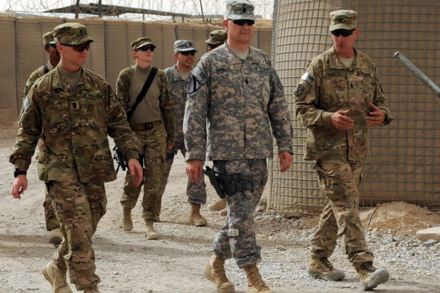 From left, Command Sgt. Maj. Christopher Greca, command sergeant major of the 10th Mountain Division (LI); Sergeant Maj. of the Army Raymond F. Chandler; and Command Sgt. Maj. James Carabello, command sergeant major of 3rd Brigade Combat Team, tour Forward Operating Base Pasab, Afghanistan, May 25.