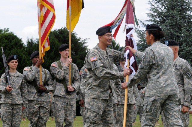 Col. John M. Cho officially assumes command of 30th Medical Command as he receives the unit colors from Brig. Gen. Nadja Y. West, commander of the Europe Regional Medical Command, during a change of command ceremony June 9 on the Nachricten Kaserne Parade Field.
