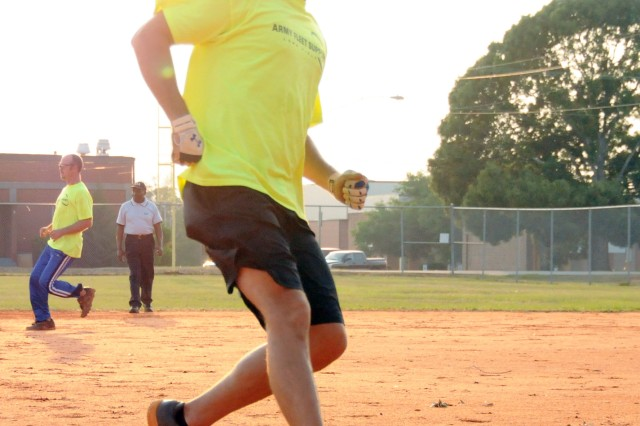 Jerrod Johnson, AFS Lowe Field shortstop, rounds third base during the team's game against the Spartans of 1st Bn., 223rd Avn. Regt. June 6 in Fort Rucker intramural softball action.