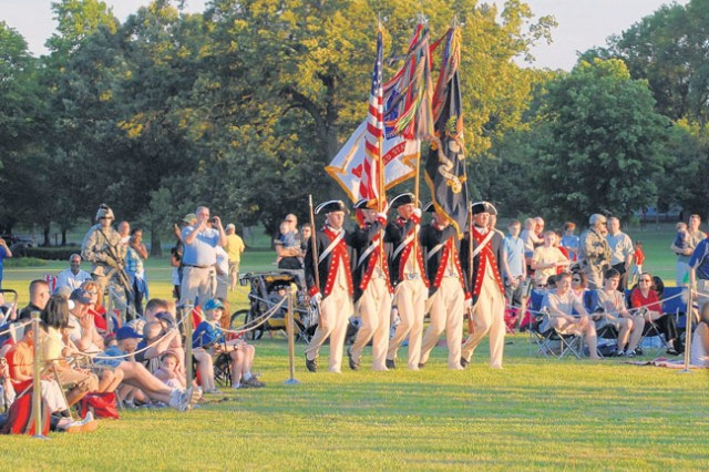 """The Continental Color Guard prepares to retire the colors at the end of the Twilight Tattoo Friday evening at Fort Belvoir's Long Field. The event was an hour-long military pageant featuring Soldiers from The 3rd U.S. Infantry Regiment (The Old Guard) and The U.S. Army Band """"Pershing's Own."""""""