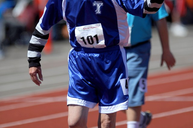 Jerry Stougard, with the City of Federal Way Thunder Track, waves after finishing first in the 400 meter walk.