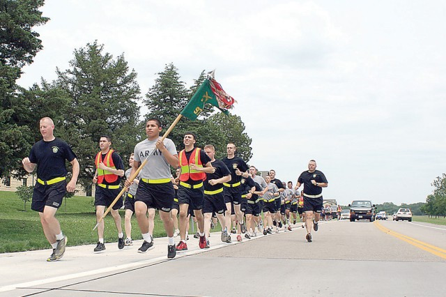 Capt. Nathan Obermeyer, commander, 977th MP Co., 97th MP Bn., far left, leads his company Soldiers June 2 in the Special Olympics Law Enforcement Torch Run.