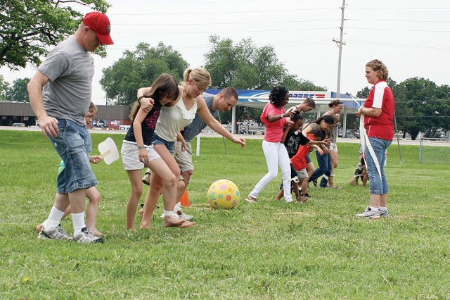 Parents and children compete in a three-legged race June 4 during the Dads Make a Difference Picnic at Rally Point Field, Fort Riley, Kan.