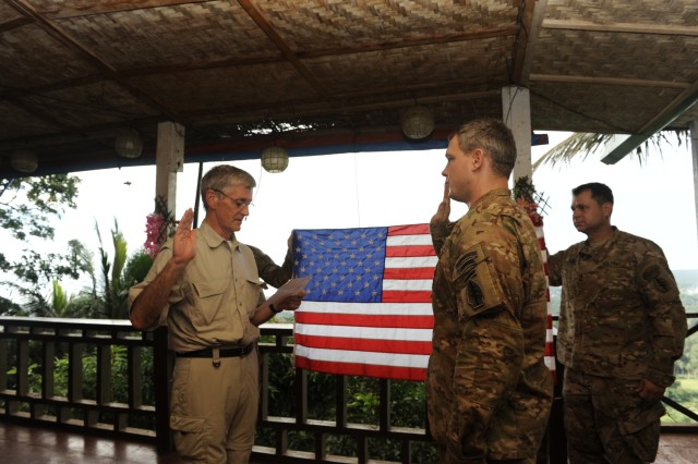Secretary of the Army John McHugh reenlists a U.S. Army Special Forces Soldier assigned to Joint Special Operations Task Force-Philippines.