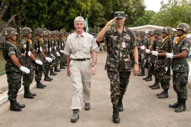 Secretary of the Army John McHugh and Armed Forces of the Philippines Brig. Gen. Gerardo Layug are greeted with official honors at Western Mindanao Command headquarters.