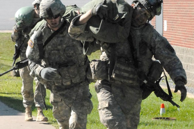 Soldiers from D Troop, 1st Squadron, 89th Cavalry Regiment, move sandbags and gear from one obstacle to the next during the Wolverine Physical Training Challenge, Friday, at Fort Drum. Troopers competed in five different events to build teamwork skills and unit cohesion.