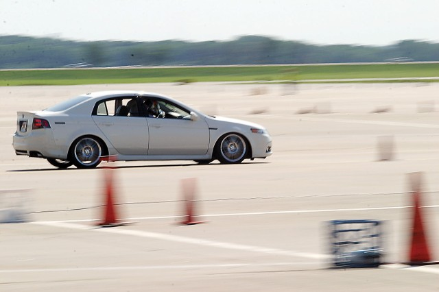Staff Sgt. Miguel Calica, HHC, 4th IBCT, and his 14-year-old son, John, make their final run during the Fort Riley Autocross June 5 at Marshall Army Airfield, Fort Riley, Kan.