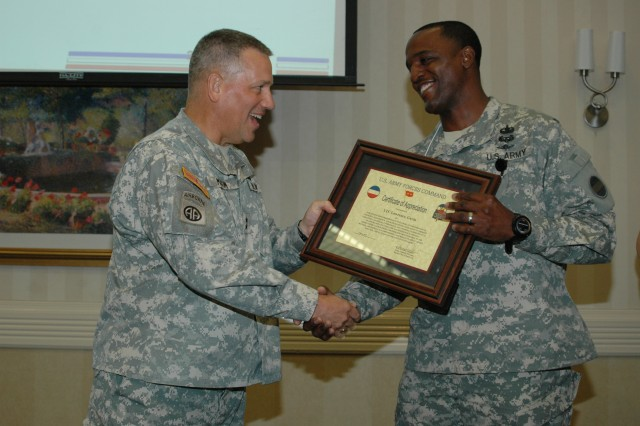 "FORT BRAGG, N.C. (June 9, 2011) – At the conclusion of the FORSCOM G-4 ""Back to Basics"" Conference, Maj. Gen. Raymond V. Mason presents a certificate of appreciation to Lt. Col. Gavin A. Lawrence of the FORSCOM G-4 staff for his part in making the conference a success."
