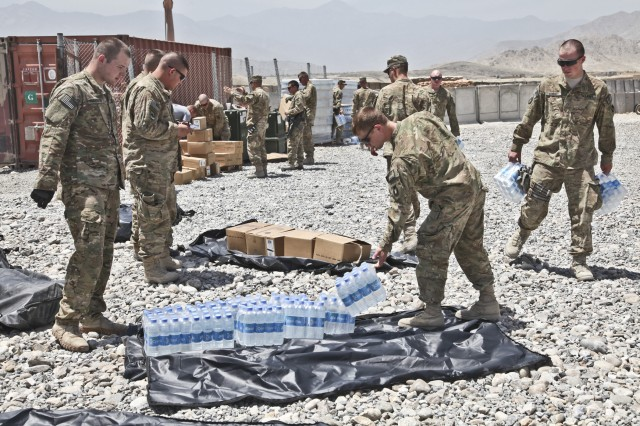 Soldiers from the 1st Battalion, 133rd Infantry Regiment, Task Force Ironman, a part of the Iowa National Guard's 2nd Brigade Combat Team, 34th Infantry Division, Task Force Red Bulls, load speed balls, or quick resupply bags, May 25, 2011, at Forward Operating Base Mehtar Lam, Afghanistan.