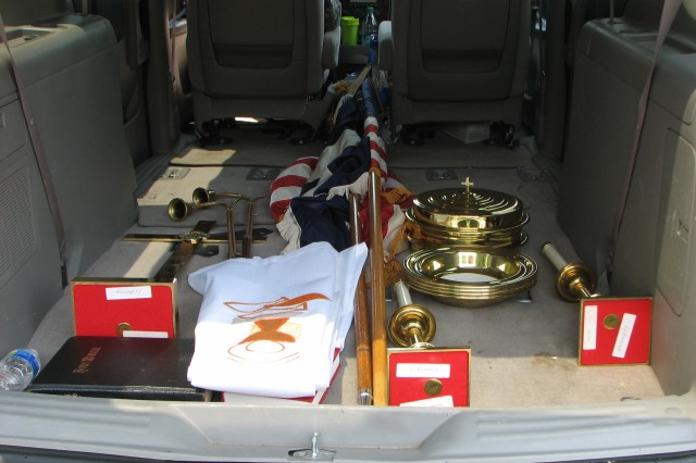 Despite the chapel closure, all items of worship, pictured here awaiting transport, will continue to find use in military chapel services. The National Colors and Christian Flag will be used for Christian worship at Fort Gordon; the altar cross and candles will be sent to Fort Dix, N.J.; the altar bible, pew hymnals, communion trays and the piano and organ will go to Fort Riley, Kan.; the keyboard and chapel sound system will go to Fort Stewart; the offering plates will go to White Sands Missile Range, N.M.; and the seasonal altar linens and colors will go to Fort Rucker, Ala.