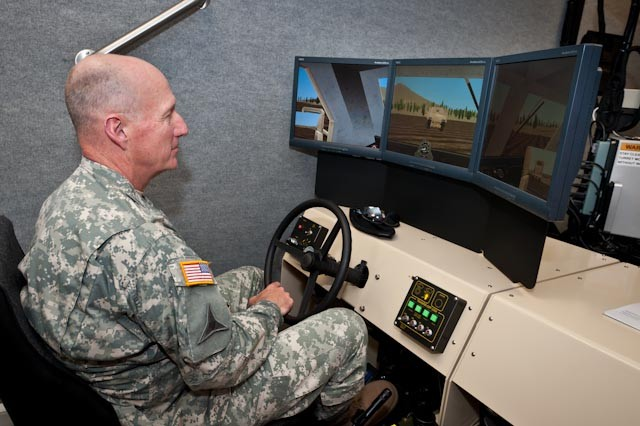 Gen. Robert Cone, U.S. Army Training and Doctrine Command commanding general, tries out a route clearance simulator at the U.S. Army's Counter Explosives Hazards Center. Cone visited Fort Leonard Wood, Mo., June 9, to meet with Maneuver Support Center of Excellence senior leaders, speak with Soldiers and to observe training that demonstrates the post's outstanding contributions to the Army's and TRADOC's focus areas.