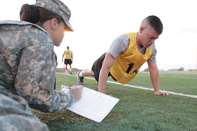 Staff Sgt. Adam Fontanez, 5th Signal Command (Theater), knocks out another push-up June 6 during the Army Physical Fitness portion of the NETCOM/9th Signal Command (Army) NCO and Soldier of the Year Competition.