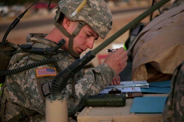 Sgt. James Williams, 1st Signal Brigade, plots his points on a map June 8 during the start of the night urban orienteering portion of the NETCOM/9th Signal Command (Army) NCO and Soldier of the Year Competition.