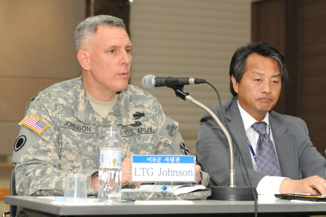 Eighth Army Commanding General Lt. Gen. John D. Johnson addresses residents at the Chilgok County Auditorium June 9. He is leading the Joint Investigation Team together with Doctor Gon Ok (right).