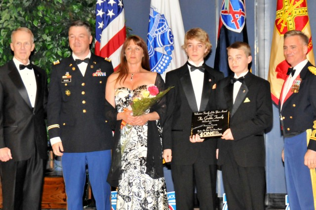 From left, retired Lt. Gen. James L. Campbell, former 10th Mountain Division (LI) commander presented the 2011 AUSA Volunteer Family of the Year award to Lt. Col. Lee Grubbs, former commander of 1st Brigade Special Troops Battalion, 1st Brigade Combat Team, along with his wife, Christy, and three sons – Jackson, Connor and Tristan during Fort Drum's inaugural Army Birthday Ball June 10.