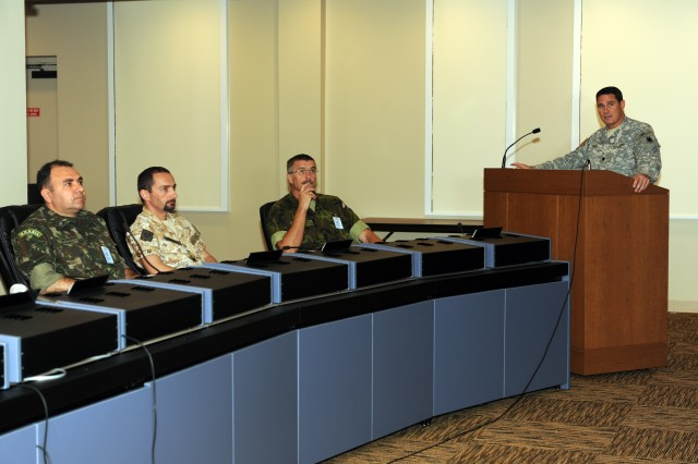 FORT SAM HOUSTON, Texas – Lt. Col. Thomas Small (right), U.S. Army South Combined Operations and Intelligence Center chief, briefs Foreign Liaison Officers (FLOs) at the Army South headquarters building here June 8. FLOs assigned to the U.S. Army Training and Doctrine Command from Brazil, the Czech Republic, Denmark, Israel, Italy, Japan, Singapore and Spain toured the Army South headquarters and received briefs on the command mission, current operations, various exercises conducted with partner armies during the past year and presentations from FLOs about their personal experience while assigned to the command. (U.S. Army photo by Robert R. Ramon, U.S. Army South Public Affairs)