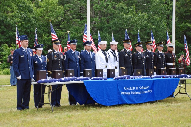GERADL B. SOLOMON SARATOGA NATIONAL CEMETERY--A joint service honor guard stands with the remains of 11 forgotten veterans during the first internment ceremony under New York's Veterans Recovery Program here on June 10.