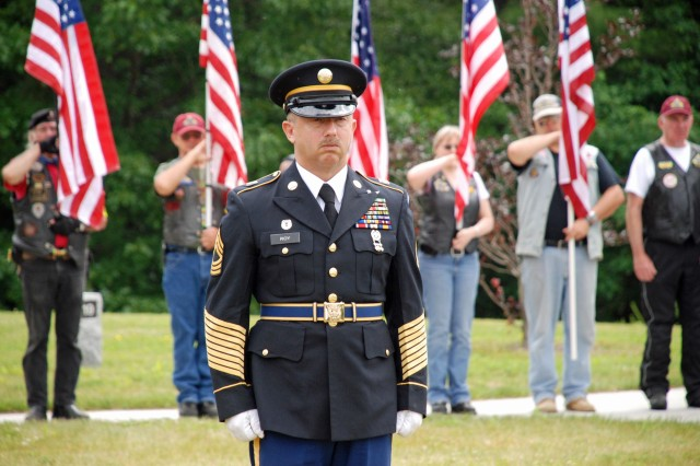 GERALD B. SOLOMON SARATOGA NATIONAL CEMETERY-- Master Sergeant (retired) Don Roy leads the New York National Guard's Military Forces Honor Guard and  the military honors program for the Veterans Recovery Program ceremony here on June 10.