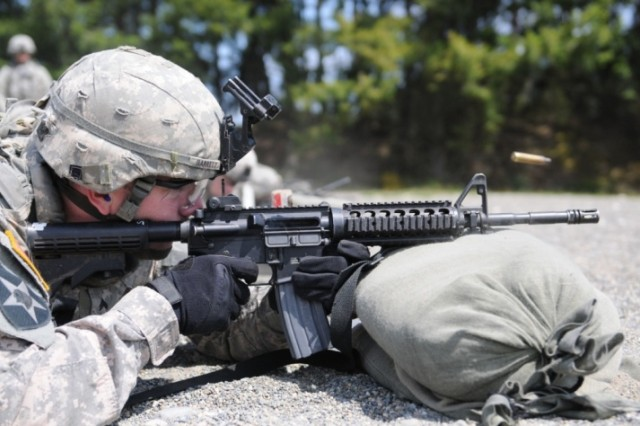 Cpl. Jesse Garrett, a combat medic from Apalachin, N.Y., fires at targets during the marksmanship portion of the three-day I Corps Soldier of the Year competition June 7 at Joint Base Lewis-McChord, Wash.