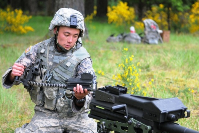 Sgt. Haidang Le, an infantryman assigned to 1st Battalion, 17th Infantry Regiment breaks down a Mark-19 grenade launcher June 8 as a test of his knowledge of the Army's commonly used weapon systems during the three-day I Corps Soldier of the Year competition at Joint Base Lewis-McChord, Wash. Le was named 2011 I Corps NCO of the Year.