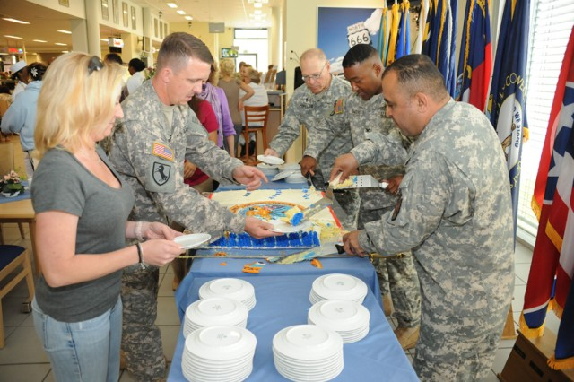 GRAFENWOEHR, Germany -- (from right) U.S. Army Garrison Grafenwoehr's Command Sgt. Maj. William Berrios, Col. Vann Smiley, commander, USAG Grafenwoehr; and Chaplain (Maj.) Stan Copeland, USAG Grafenwoehr family life chaplain serve cake to Soldiers and family members during the Army's 236th birthday celebration at the Main Post Dining Facility, June 14.