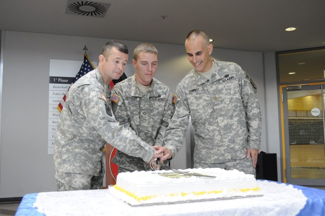 From left to right, 1st Sgt. David Thornton, 173rd Special Troops Battalion, 173rd Airbone Brigade Combat Team, Pfc. Tyler Siegrest, 173rd STB, 173rd ABCT, and Maj. Seamus Garrett, Provost Marshal for Warner Barracks, cut a birthday cake for the Army's 236th birthday at the Freedom Fitness Facility June 14. The Army tradition is to have the youngest, Siegrest, and oldest, Thornton, Soldiers cut the cake.