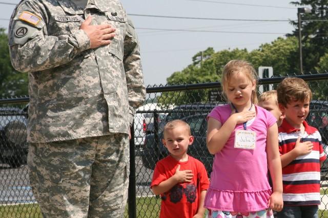 First Sergeant Greg Stevens, Letterkenny Sergeant Major leads children from the Child Development Center in reciting the Pledge of Allegiance.