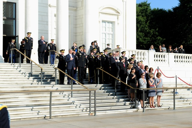 The Secretary of the United States Army John McHugh and the Army's General Staff salute during the United States National Anthem during the Army Birthday Wreath Laying Ceremony, June 14, 2011, at the Tomb of the Unknowns, at Arlington National Cemetery, Va.