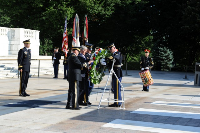 "The Secretary of the United States Army John McHugh (middle), U.S. Army Chief of Staff Gen. Martin E. Dempsey (right), and Sgt. Maj. of the Army Raymond F. Chandler III (left), lay a Wreath in honor of the  Army's Birthday as Maj. Gen. Michael S. Linnington, commander of the U.S. Army Military District of Washington, 3rd US Infantry Regiment, ""The Old Guard,"" Joint Force Headquarters-National Capital Region, looks on during the Army Birthday Wreath Laying Ceremony, June 14, 2011, at the Tomb of the Unknowns, at Arlington National Cemetery, Va."