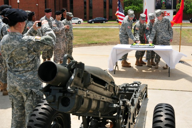 The oldest, and youngest member of First Army Division East, along with Maj. Gen. Kevin R. Wendel, commanding general, and Command Sgt. Maj. Edwin Rodriguez slice the Army birthday cake during a ceremony held at Division East Headquarters June 14, 2011.