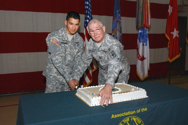 LATHAM, N.Y. - The New York Army National Guard's oldest and youngest members at the Joint Force Headquarters celebrate the 236th birthday of America's Army here June 14.  Cutting a celebratory cake are Pvt. Jamie Spaulding, 19, 42nd Combat Aviation Brigade and Command Sgt. Major Robert Van Pelt, 62, the New York Army National Guard State Sergeant Major.  U.S. Army photo by Sgt. 1st Class Steven Petibone, New York Army National Guard.