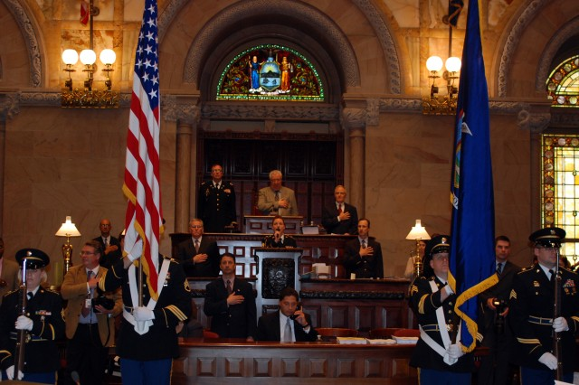 ALBANY, N.Y. -- New York State Senator Carl Marcellino, acting President pro Tempore of the New York State Senate leads the senate in the Pledge of Allegiance to mark the opening session of the New York State Senate here June 14.   The New York Army National Guard color guard opened the session to mark the Army Birthday and Flag Day.