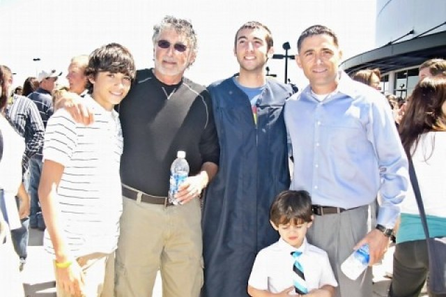 Master Sgt. Douglas A. Bram poses with his father, Rich Bram, and his three sons, from left: Tyler, Preston and Aiden, during Tyler's high school graduation. Bram is the operations noncommissioned officer in charge of the RSSC-Europe, U.S. Army Space and Missile Defense Command/Army Forces Strategic Command in Stuttgart, Germany.