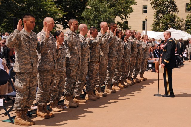Army Chief of Staff Gen. Martin Dempsey re-enlists 14 Soldiers during Army's 236 birthday festivities in the Pentagon center courtyard, June 14, 2011.