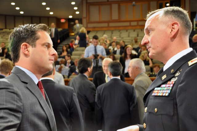 Arsenal Commander Col. Mark Migaleddi takes a moment before the Veterans Hall of Fame Ceremony to talk to New York Senator Greg Ball.