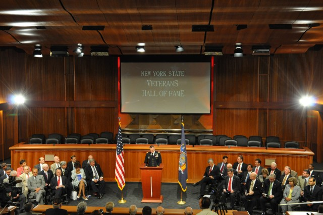 Arsenal Commander Col. Mark Migaleddi addresses New York State Senators, honored Veterans and their families during the State's Veterans Hall of Fame Ceremony on June 14.
